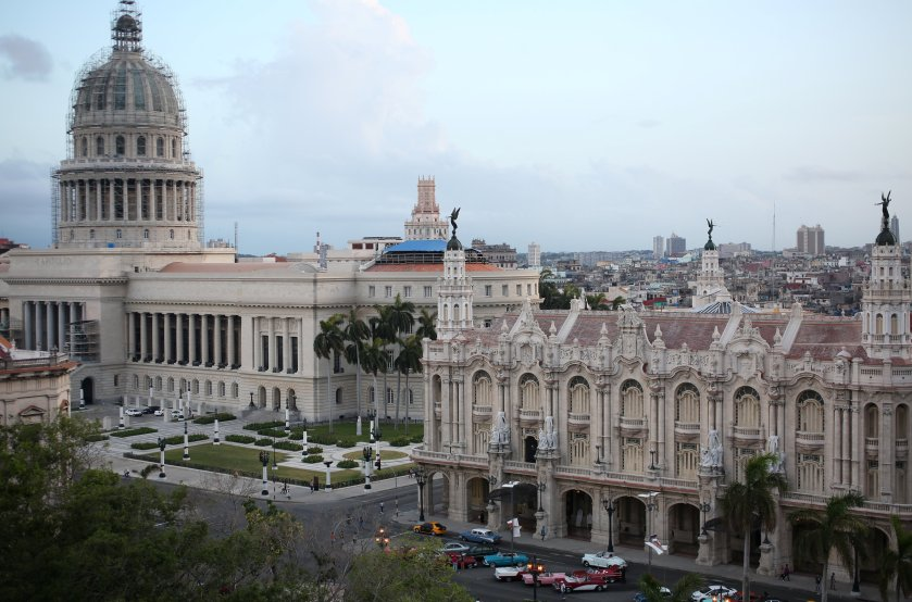 The National Capitol Building and the Gran Teatro de la Habana Alicia Alonso on the Paseo del Prado boulevard are seen from the rooftop of the Hotel Gran Manzana, in Havana